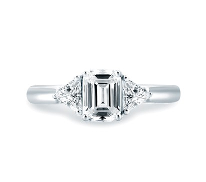 CLASSIC THREE STONE EMERALD CUT CENTER ENGAGEMENT RING